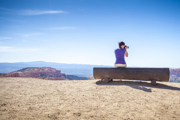 Tourist photographing nature in Bryce Canyon National Park