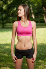 Beautiful slender young fitness girl.