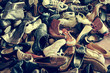 second hand shoes in a flea market, with a retro filter effect - 67874036