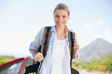 Attractive hiking blonde smiling at camera