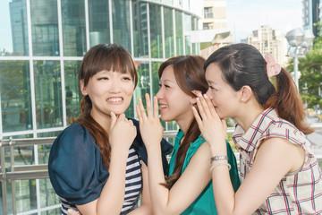 Asian friends' whisper
