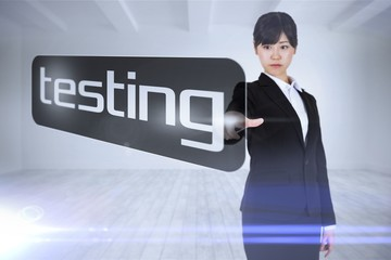 Businesswoman pointing to word testing