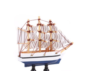 Boat model. Small wooden ship.