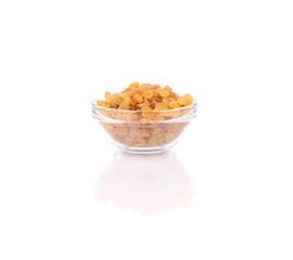 Glass bowl with raisins.