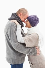 Happy mature couple in winter clothes embracing