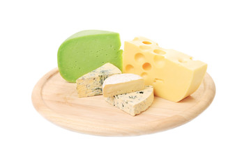 Various cheese on wooden plate.