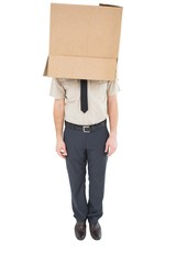 Businessman standing with box on head