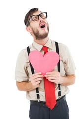 Geeky hipster crying and holding heart card