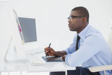 Focused businessman sitting at his desk working