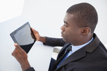 Focused businessman looking at his tablet
