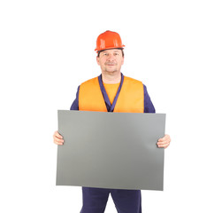 Worker in hard hat with paper.