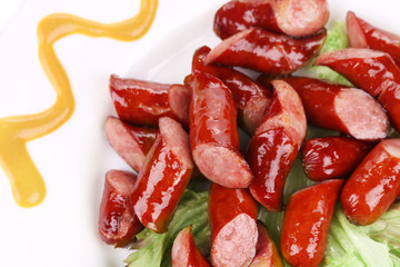Close up of salad with sausages.