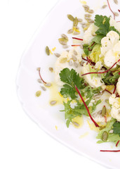 Cauliflower salad with seeds and parsley.