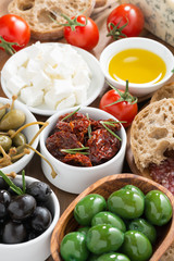 assorted Italian antipasti - olives, pickles and bread, top view