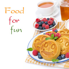 corn pancake with fresh berries, tea and honey, isolated