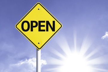 Open road sign with sun background