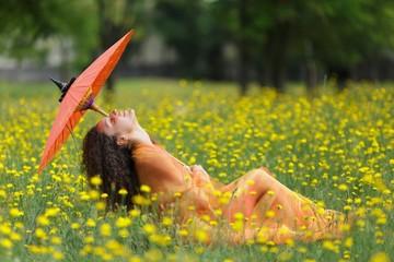 Beautiful elegant woman with an orange parasol