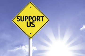 Support Us road sign with sun background
