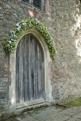 Old Wooden Church Door with Daisy Bouquet