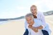 Leinwanddruck Bild - Senior man giving piggyback ride to wife
