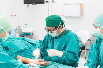 surgeon and team operating arteriovenous fistula for long term d