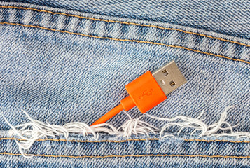 Red USB cable in jeans pocket