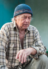 Seniors portrait of contemplative old caucasian man looking down
