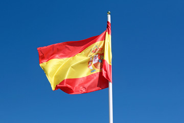 spanish flag against blue sky