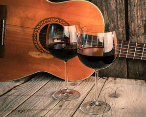 guitar and Wine on a wooden table romantic dinner background