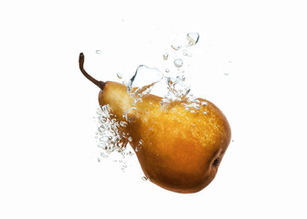 pear dropped into water splash on white