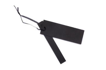 black gift tag tied with a string
