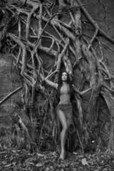 Beautiful young Woman near Banyan Tree in the rainforest in Indi