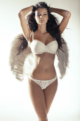 Beautiful woman with the white wings
