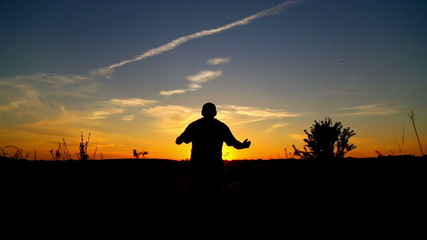 Man at sunset in the field (running, jumping)
