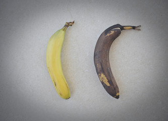 two bananas: one good and one rotten