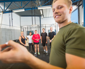 Instructor Training Athletes At Gym