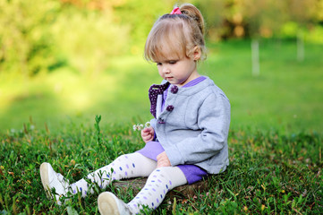 Portrait of adorable child girl walking outdoors