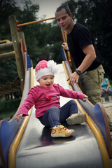 Little girl on the slide