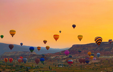 Hot air balloon flying rock landscape