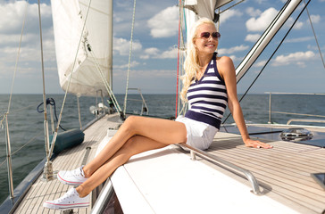 smiling young woman sitting on yacht deck