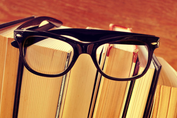 books and eyeglasses, with a retro effect