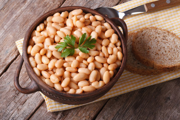cooked white kidney beans in a bowl closeup horizontal top view