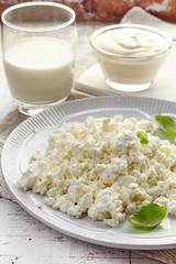 cottage cheese and dairy products on white wooden table