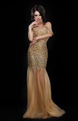 Formal Party. Glamorous Fashion Model in Elegant Golden Dress