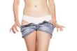 woman undresses her short jeans pants