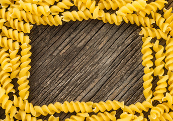 Pasta wooden background