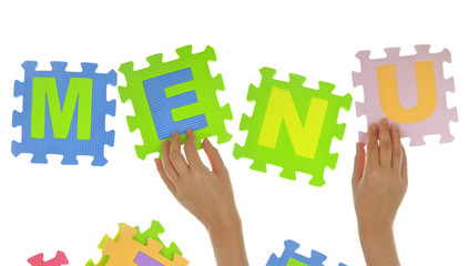 "Hands forming word ""Menu"" with jigsaw puzzle pieces isolated"