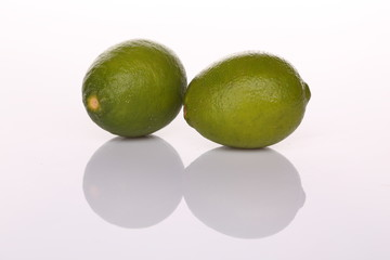 Limes with shadow isolated on white background