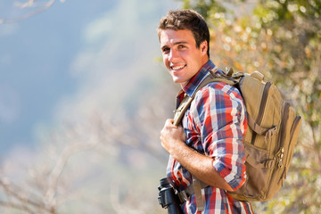 young man in autumn mountain