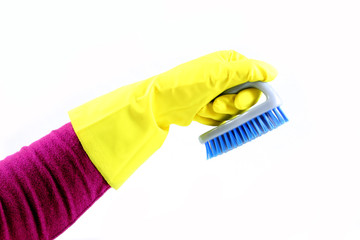 Hand with brush and glove